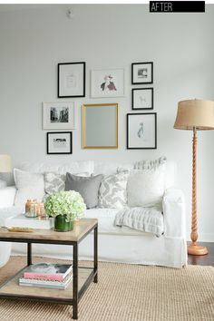Lovely looking living room but the sofa would not last a day in my home. Love how the center mirror frame ties in with the lamp on the right.