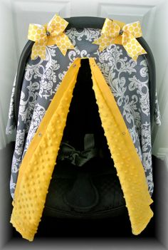 MINKY gray, YELLOW, and white damask print car seat canopy / car seat cover with polka dot bows.