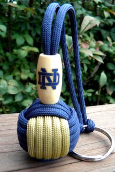 Notre Dame Paracord Monkey Fist Keychain Handmade Going to try and make these with our scouts on camp. How hard can it be. Paracord Ideas, Paracord Knots, Paracord Projects, Macrame Projects, Paracord Bracelets, Diy Craft Projects, Projects To Try, Monkey Fist Keychain, Lanyards