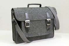 Felt 15 laptop case made of strong stabilized (impregnated) felt and strong full grain leather. It protects your device from shock, dust and scrapes.   Tailormade for the laptop 15 and other device of this size  We can also made it in other size. Please feel free to contact us.   All products are handmade in our manufacture in Poland  Best material and quality.