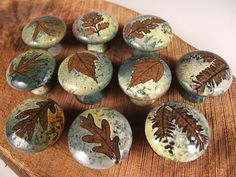 10  ceramic cabinet knobs/drawer pulls in green leaf glaze, via Etsy.