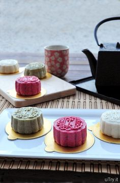 Ice Skin Moon Cake filled with black sesame paste and red bean paste.  The skin is made with all natural colors from Matcha powder and Pomegranate juice.