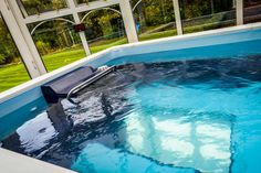 The Endless Pools® swim current allows you to swim in place for fun and fitness in a compact, easy-to-maintain installation. The modular design assembles outdoors or in, even in existing rooms like this conservatory. Get inspired with a Free Idea Kit from www.endlesspools.com.