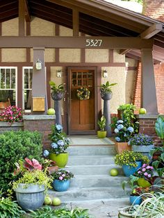 Bright surrounding colors make this front door look friendly and inviting. See more of our favorite front doors here: http://www.bhg.com/home-improvement/exteriors/curb-appeal/craftsman-style-home-ideas/?socsrc=bhgpin041515craftsmanfrontdoor&page=1