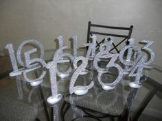 DIY Bling Table Numbers, but maybe spray paint with metallic paint & cover with glitter??!!