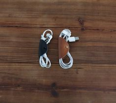 The cord taco will help you clean up all of those wires in your bag, pocket, car or wherever they are. The premium leather greatly changes the look from messy to cool and organized. - http://thegadgetflow.com/portfolio/assorted-cord-tacos-25/