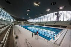 """London aquatics centre, Stratford (2012), The """"most jaw-dropping municipal swimming pool in the world"""", according to the Guardian. Originally built for the 2012 Olympics at a cost of £269m, this cathedral-like space seats houses two 50-metre pools and seats for 2,500 spectators. Its wave of a roof rests on just three concrete supports, and huge windows let the light flood in."""