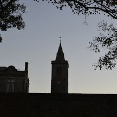 St Salvator's clock tower with autumn branches seen from The Scores in St Andrews.