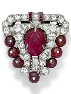An Art Deco ruby, diamond and platinum clip by Bert H. Satz. #Satz #ArtDeco… …