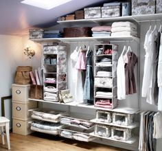 A flexible wall storage system built to fit a slanted ceiling, storing boxes, clothes and shoes