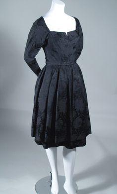 1950'S VINTAGE BLACK SILK GALANOS COCKTAIL DRESS. Available at rpvintage.com