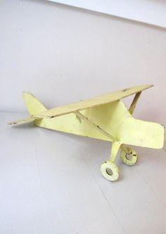 vintage yellow metal airplane