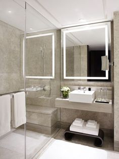 serene shower room in pale stone with gorgeous lighting - Marriott Singapore, hba