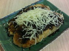 Pisang bakar - Indonesian grilled banana with chocolate sprinkles and cheese