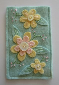 pretty pastel hand embroidery and vintage button mobile cosy. £7.50, via Etsy.