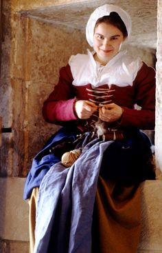 re enactment, young woman spinning wool