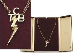 Elvis' TCB Necklace. They were only given to His closest friends, along with a copy of the TCB Oath.