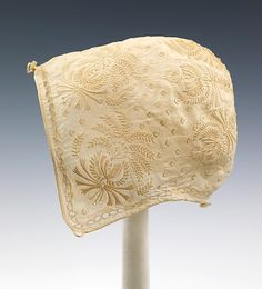 """Baby cap, c. 1813, """"worn by the brother of Harriet Beecher Stowe,"""" (1811-1896) author of the great novel Uncle Tom's Cabin."""