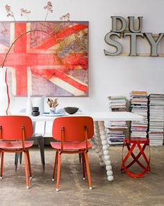 red-orange... great chairs, table legs and that Union Jack!