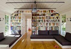 Built in couch areas (w/ storage underneath) & bookshelf into wall (via Twiggy and Lou: Tiny House)