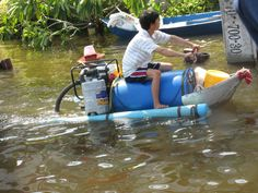 Oil Barrel + Garden Pump = Homebuild Jetski. Seen in Thaliand.