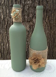 Sage hand painted wine bottles with twine and burlap flowers. Set of 2