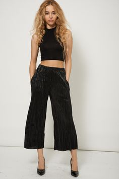 "GLITTERY PLEATED FLARED TROUSERS Glittery Pleated Flared Trousers Ex-Branded Plus Sizes Available  This item is ex-branded and will therefore have the labels cut  Key features:  Black Colour Elasticated Waist Soft Fabric Pleated Style  Material: 100% Polyester  Measurements:  Model is 5' 7"" and wears a size UK8 Waist across one side approx. 32cm Inner leg approx. 58cm Length from waist to hem 84cm"