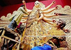 Durga Pujas    Durgadevi statue is the golden structure   in Kolkata