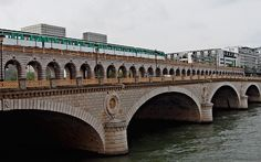 The Pont de Bercy is a bridge over the Seine in Paris, France.    The structure links the 12th and 13th arrondissements of Paris by extending the Boulevard de Bercy and the Boulevard Vincent-Auriol. In addition to roadway, the bridge also carries line 6 of the Paris Metro.