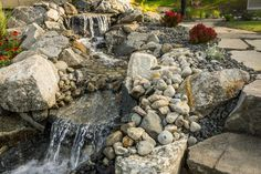 The team took advantage of the terrace landscape with a serene waterfall that runs next to steps leading back to the house.