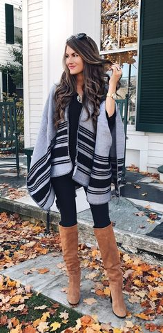 Gray and black striped poncho over all black with tan OTK boots.