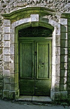 Green doors, stone building