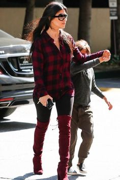Kourtney Kardashian wearing Hermes Tassel Keychain in Black, Stuart Weitzman Highland Boots in Bordeaux Suede, Rails Hunter Long Sleeve Button Down Shirt in Navy and Wine and Celine Adele 41377 Sunglasses
