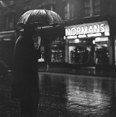 London, Charing Cross Road, (umbrella at Normans), 1937. By Wolf Suschitzky