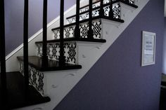 DIY vinyl decals on stairs. I love the black and white with the colored walls.