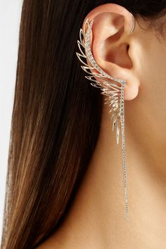 Winged ear cuff. I am not actually a fan of the long dangly earrings, but I like this one.