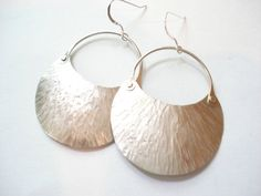These earrings are made from German silver metal and the same material wire. I cut the earrings from a solid sheet of the silver