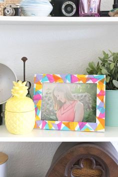 This DIY decoupaged geometric tissue paper frame is perfect for whipping up quickly and adding color to your home!