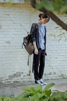 converse w/ trousers; navy color scheme; grey canvas backpack; loose