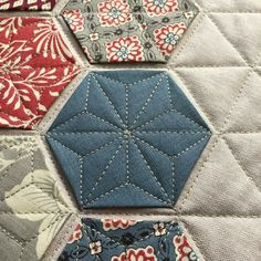 Love the quilting on this modern hexie!