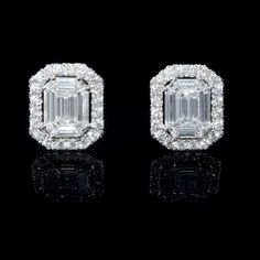 This elegant pair of 18k white gold cluster earrings, features 2 emerald cut, 16 baguette cut and 40 round brilliant cut white diamonds of F color, VS2 clarity and excellent cut and brilliance, weighing 2.07 carats total.  These cluster earrings contain post and push backs. These earrings measure 13mm x 11mm.  #holidaygiftguide