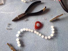 On the making table today, white jade gemstone and a rich autumnal orange agate