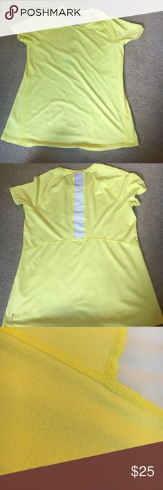 Lucy yellow light weight shirt Excellent quality... Lucy yellow light weight shirt with a cut out in the back. (White part). Lucy Tops Tees - Short Sleeve