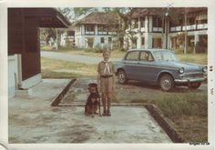 48 Hobart Road shows me in my cub uniform with dad's Hillman Minx (Robert Blyth) and our house 68 Falkland Road in the background. The dog was Nobby. We adopted him when someone left Singapore to go back to the UK.