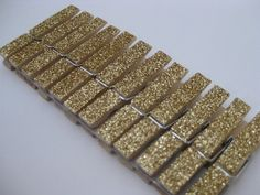 Good price, nice size clothespins. Set of 100  Gold Glitter Clothespins  Place by TheGlitterShoppe, $50.00