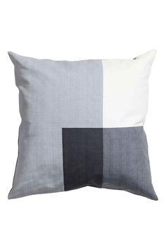 Copricuscino color-block: Copricuscino in tessuto di cotone con motivo color-block stampato. Cerniera nascosta.