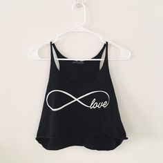 Brandy Melville infinite love tank Worn only once for a couple of hours and then washed so it's almost new. Perfect condition :)  -trades only for posted ISOs. My iso page can be found near the top of my closet. DO NOT ASK TO TRADE IF YOU DO NOT HAVE ONE OF MY ISOS. Brandy Melville Tops Tank Tops