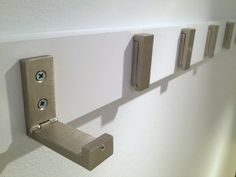 These IKEA coat hooks fold away when not in use, making it great for a busy staircase wall - The Handyman's Daughter