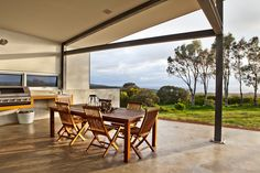 The Contemporary Weekender by Twinkle & Whistle (for Scoop Magazine) - Outdoor Area: polished concrete floors, steel beams, outdoor kitchen/barbecue... and an amazing view! - Craig Steere Architects