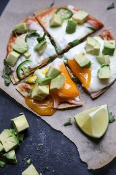 This Mexican breakfast pizza recipe is an easy way to add a little taco love and spice to your morning! Using corn tortillas, it's also gluten-free!
